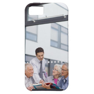 Adult students and teacher studying together in iPhone 5 cases