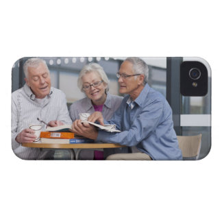 Adult students studying together in cafe iPhone 4 cover