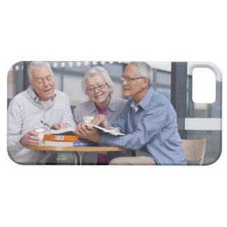 Adult students studying together in cafe iPhone 5 case