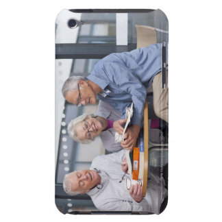 Adult students studying together in cafe iPod Case-Mate case