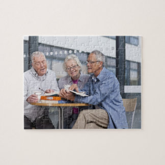 Adult students studying together in cafe jigsaw puzzle