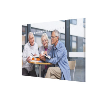 Adult students studying together in cafe stretched canvas prints