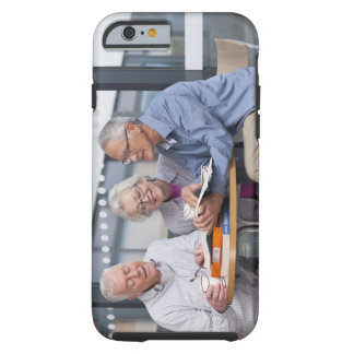 Adult students studying together in cafe tough iPhone 6 case