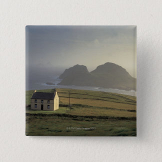 aerial view of a cottage on a hill by the sea 15 cm square badge