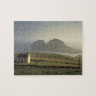 aerial view of a cottage on a hill by the sea jigsaw puzzle