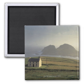 aerial view of a cottage on a hill by the sea magnets
