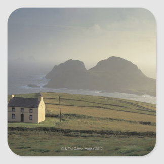 aerial view of a cottage on a hill by the sea square sticker