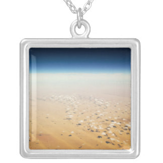 Aerial view of a desert silver plated necklace