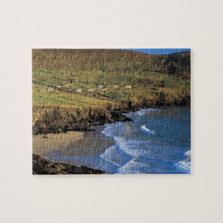 aerial view of waves washing up against a jigsaw puzzle