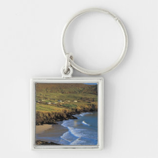aerial view of waves washing up against a Silver-Colored square key ring
