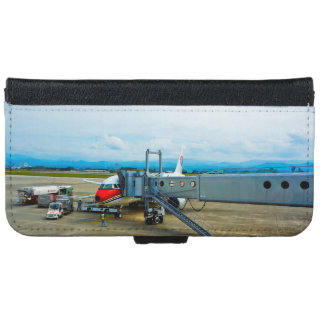 Aeroplane loaded with cargo at a terminal iPhone 6 wallet case
