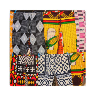Africa, Angola, Benguela. Brightly Colored Pants Wood Coaster