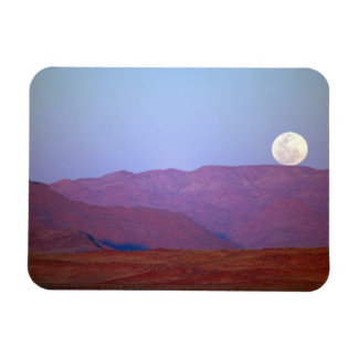 Africa, Namibia, Sossusvlei. A full moon rests Magnet