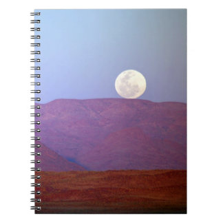 Africa, Namibia, Sossusvlei. A full moon rests Notebook