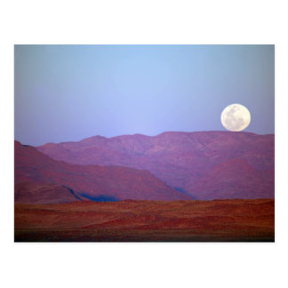 Africa, Namibia, Sossusvlei. A full moon rests Postcard