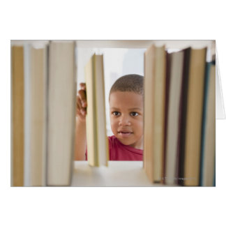 African American boy selecting book Card