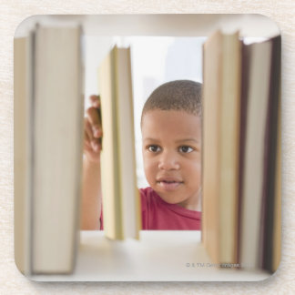 African American boy selecting book Coaster