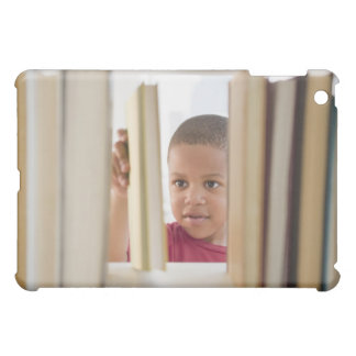 African American boy selecting book iPad Mini Cover