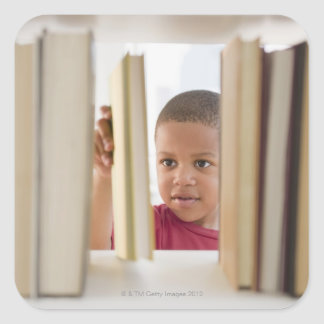 African American boy selecting book Square Sticker