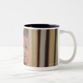 African American boy selecting book Two-Tone Coffee Mug