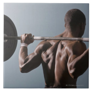 African American man working out the gym 2 Tile