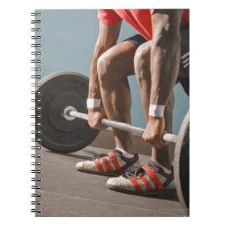 African American man working out the the gym Note Book