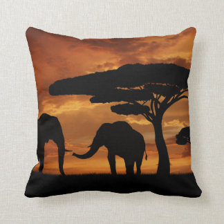 African elephants silhouettes in sunset cushion