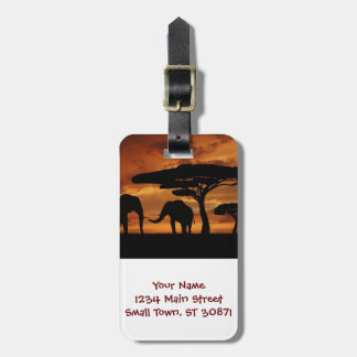 African elephants silhouettes in sunset luggage tag