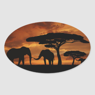 African elephants silhouettes in sunset oval sticker