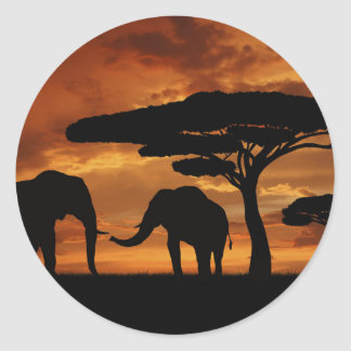 African elephants silhouettes in sunset round sticker