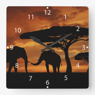 African elephants silhouettes in sunset wall clocks