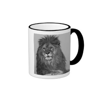 African Lion resting on rock cliff Coffee Mugs