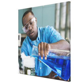 African man performing experiment in chemistry canvas print