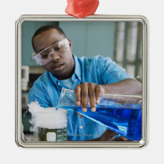 African man performing experiment in chemistry christmas ornament