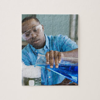 African man performing experiment in chemistry jigsaw puzzle