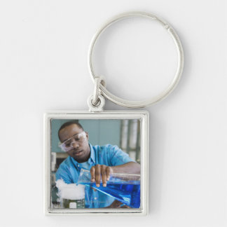 African man performing experiment in chemistry key ring