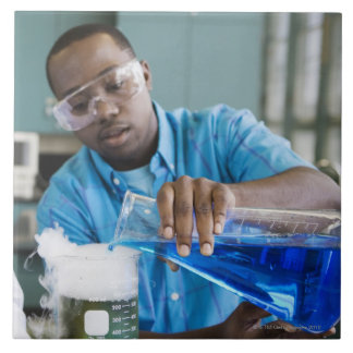 African man performing experiment in chemistry tile