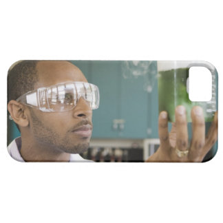 African scientist examining experiment in case for the iPhone 5