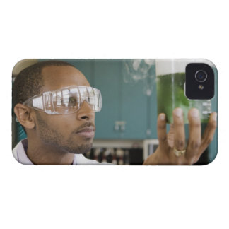 African scientist examining experiment in iPhone 4 covers