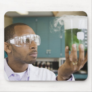 African scientist examining experiment in mouse pad