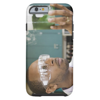 African scientist examining experiment in tough iPhone 6 case