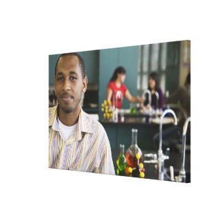 African teacher in chemistry lab canvas print