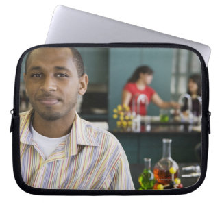 African teacher in chemistry lab computer sleeves
