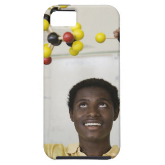 African teenage boy viewing molecule model tough iPhone 5 case