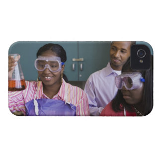 African teenage girl examining experiment in iPhone 4 covers