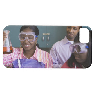 African teenage girl examining experiment in iPhone 5 cases