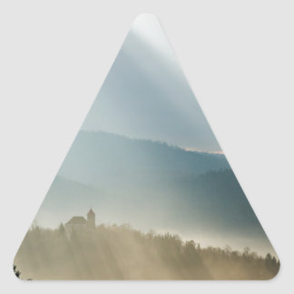 Afternoon rays over church triangle sticker