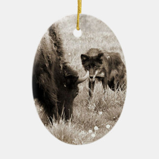 Aggressive wolf hunting bison ceramic oval decoration