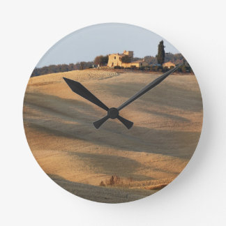 Agricultural field at sunset, Val d'Orcia, Tusca Round Clock
