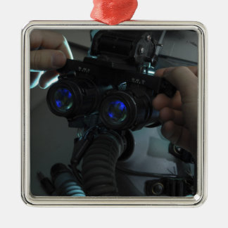Airman adjusts the eyespan christmas ornament